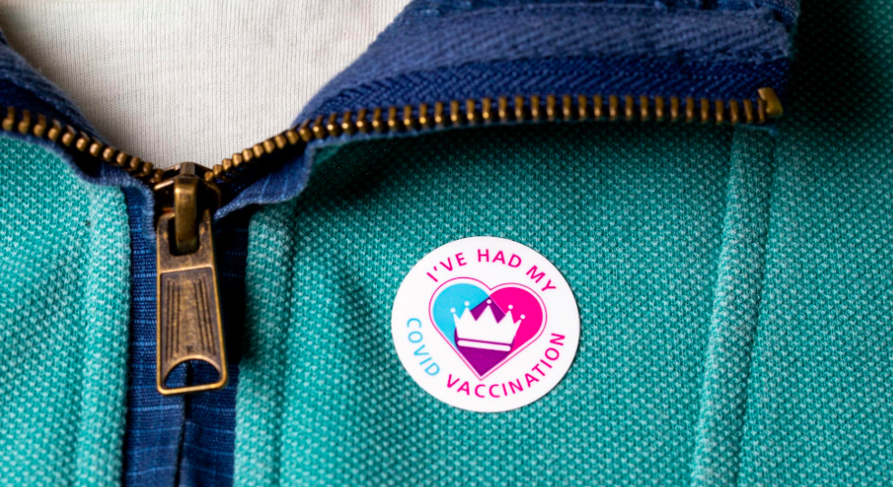 """Photo of a person wearing their """"I've had my covid vaccination"""" sticker"""